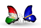 Butterflies with Tajikistan and Nauru flags — Stock Photo