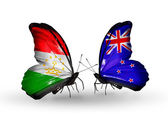 Butterflies with Tajikistan and New Zealand flags — Stock Photo
