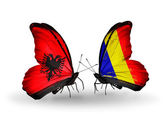 Butterflies with Albania and Chad, Romania flags — Zdjęcie stockowe