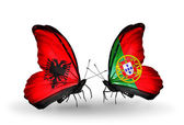 Butterflies with Albania and Portugal flags — Stock Photo