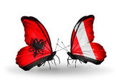 Butterflies with Albania and Peru flags — Stock Photo