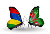 Butterflies with  Mauritius and Turkmenistan flags — Stock Photo