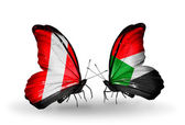 Butterflies with Peru and  Sudan flags — Stock Photo