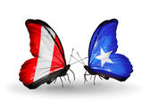 Butterflies with Peru and Somalia flags — Foto de Stock