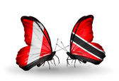 Butterflies with Peru and Trinidad and Tobago flags — Stock Photo