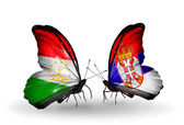 Butterflies with Tajikistan and Serbia flags — Zdjęcie stockowe
