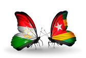 Butterflies with Tajikistan and Togo flags — Stock Photo