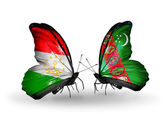 Butterflies with Tajikistan and Turkmenistan flags — Stock Photo
