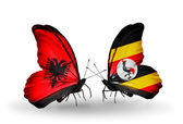 Butterflies with Albania and Uganda flags — Stock Photo
