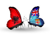 Butterflies with  Albania and Fiji flags — Stock Photo