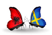 Butterflies with Albania and Sweden flags — Stock Photo