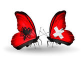 Butterflies with Albania and Switzerland flags — Foto de Stock