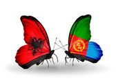 Butterflies with Albania and Eritrea flags — Stock Photo