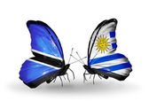 Butterflies with  Botswana and Uruguay flags — Zdjęcie stockowe