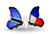 Butterflies with Botswana and Philippines flags — Stock Photo