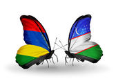 Butterflies with Mauritius and Uzbekistan flags — Stock Photo