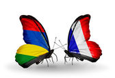 Butterflies with Mauritius and  France flags — Stock Photo