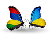 Butterflies with Mauritius and Ukraine flags — Stock Photo
