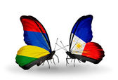 Butterflies with Mauritius and Philippines flags — Stock Photo