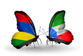 Butterflies with Mauritius and Equatorial Guinea flags — Stock Photo