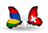 Butterflies with Mauritius and Switzerland flags — Stock Photo