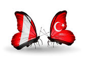 Butterflies with Peru and Turkey flags — Stock Photo