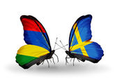 Butterflies with Mauritius and Sweden flags — Zdjęcie stockowe