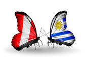Butterflies with Peru and Uruguay flags — Zdjęcie stockowe