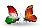 Butterflies with Tajikistan and Sri Lanka flags — Zdjęcie stockowe