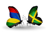 Butterflies with  Mauritius and Jamaica flags — Stock Photo
