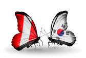 Butterflies with Peru and South Korea flags — Zdjęcie stockowe