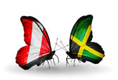 Butterflies with Peru and Jamaica flags — Stock Photo
