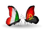 Butterflies with Cote Divoire and Angola flags — Stock Photo