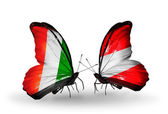 Butterflies with Cote Divoire and Austria flags — Stock Photo