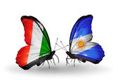 Mariposas con banderas de cote divoire y argentina — Foto de Stock