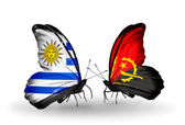 Butterflies with Uruguay and Angola flags — Stock Photo