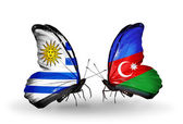 Butterflies with Uruguay and Azerbaijan flags — Stock Photo