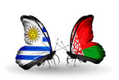 Butterflies with Uruguay and Belarus flags — Stock Photo
