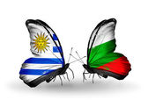 Butterflies with  Uruguay and Bulgaria flags — Stock Photo
