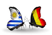 Butterflies with Uruguay and Belgium flags — Stock Photo