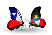 Butterflies with Chile and Antigua and Barbuda flags — Zdjęcie stockowe