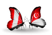 Butterflies with Peru and Singapore flags — Stock Photo