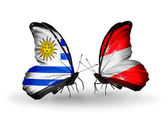 Butterflies with  Uruguay and Austria flags — Zdjęcie stockowe
