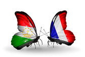 Butterflies with  Tajikistan and France flags — Stock Photo