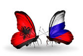 Butterflies with Albania and Russia flags — Stock Photo