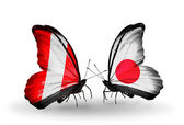 Butterflies with Peru and Japan flags — Stock Photo