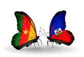 Butterflies with Cameroon and Haiti flags — Stock Photo