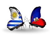 Butterflies with Uruguay and Haiti flags — Stock Photo