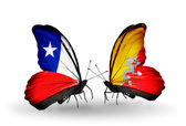 Butterflies with Chile and Bhutan flags — Stock Photo