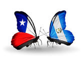 Butterflies with Chile and Guatemala flags — Stock Photo